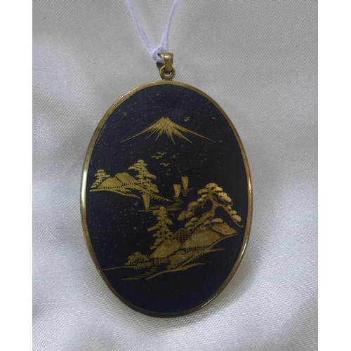 326 - A circa 1890's Chinese oval porcelain pendant in a gilt brass mount to pendant loop, 6 x 4cm...