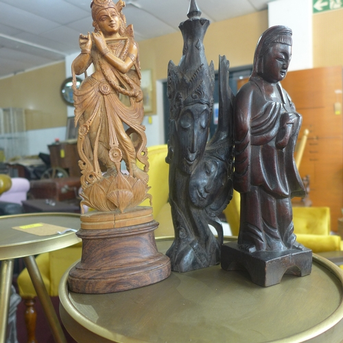 354 - Three hand-carved Oriental hardwood sculptures of females, 30 x 10cm, 25 x 7cm and 29 x 8cm...