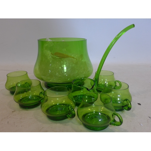 40 - A mid-century, hand-blown green glass punch bowl with matching ladle and 6 glasses, Punch bowl: 19.5...