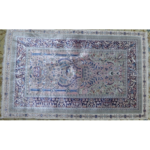 41 - A pure silk European Hereke style rug, with bird and floral motifs on a pink ground, within embossed...