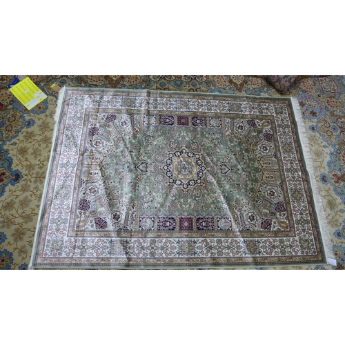 421 - A Keshan style carpet, central floral medallion on a green ground, within floral border, 230 x 160cm...