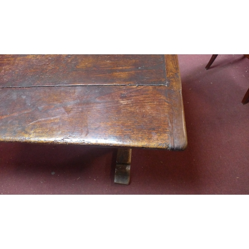 131 - A 19th century oak refectory table, on square legs joined by stretcher H: 77cm x L: 199cm x D: 77cm...