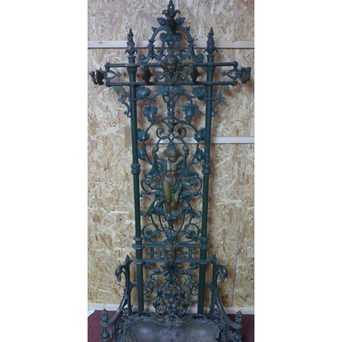162 - A Coalbrookdale cast iron hall stand, scrolling grape vine decoration with cherubs and masks, above ...