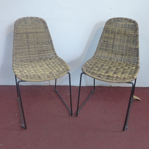 190 - Two Habitat rattan dining chairs, metal supports (2)...