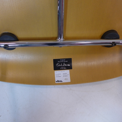 72 - An Eames LCM padded chair, Vitra serial no. to underside, raised on splayed legs, H.65cm...