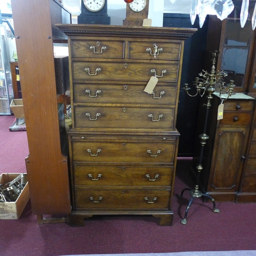 241 - An oak chest on chest, with dentil cornice, having two small drawers over three long graduating draw...