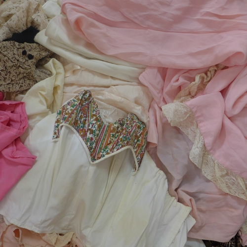 280 - A collection of vintage clothing to include cotton blouses, a 1920's silk and lace bias-cut dress an...