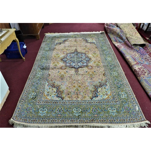 108 - A 20th century Kirman silk carpet with central floral medallion, surrounded by vase of flower motifs...