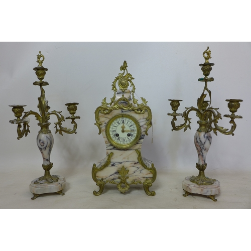 169 - A 20th century French gilt metal and marble clock and matching candelabra's...