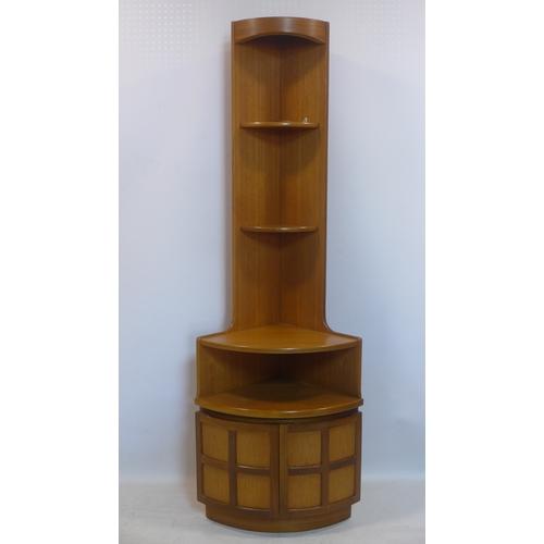 313 - A 20th century teak corner unit by Nathan, H.194 W.63 D.45cm...