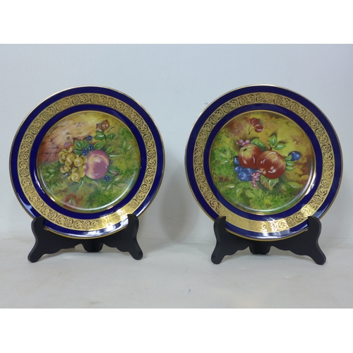 19 - A pair of Limoges hand painted limited edition plates, signed A.J Heritage, D.22cm...