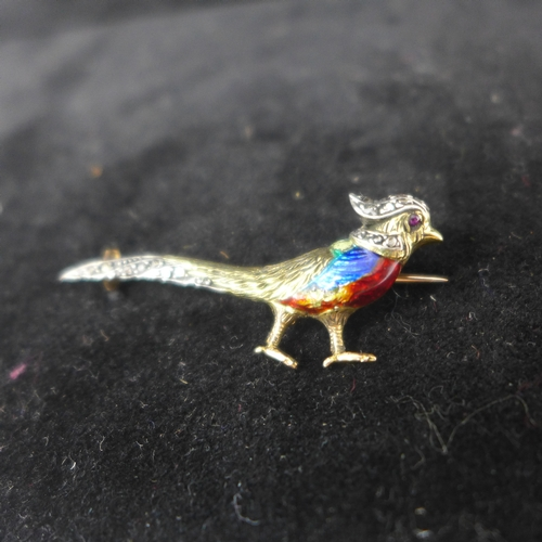 8 - A Victorian yellow and rose gold brooch in the form of a pheasant with a brightly-coloured enamel bo...