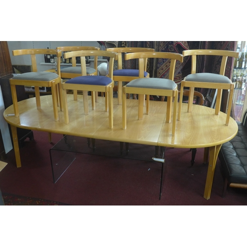 131 - A 1980's Bernt Petersen Danish dining table and six chairs model 301 for Soborg Mobler, with 2 extra...