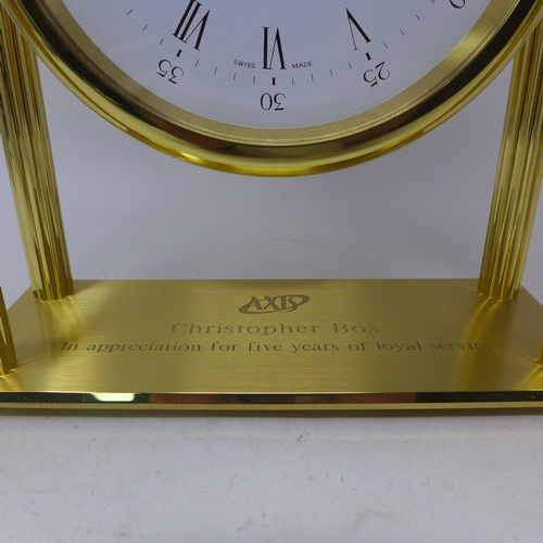 3 - A Tiffany & Co, brass mounted mantle clock having four ribbed columns, circular white dial with blac...