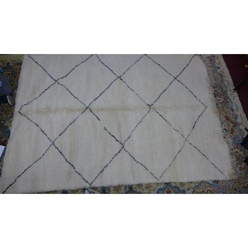 10 - A Moroccan Berber Beni Ourain rug, with diamond design, 314 x 212cm...