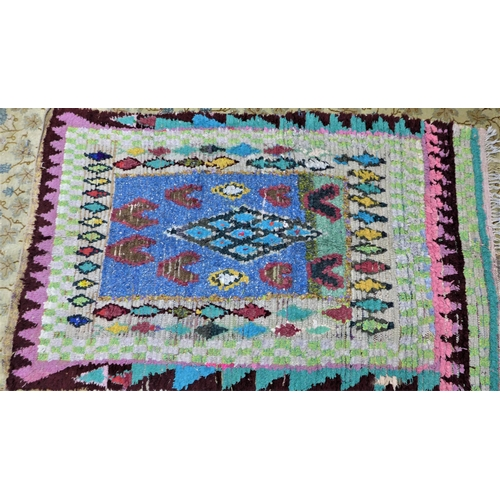 11 - A vintage Moroccan Berber Boucherouite rug, with diamond medallions, 177 x 114cm...