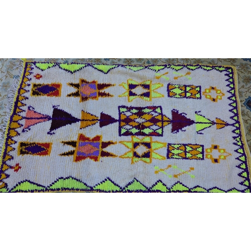12 - A vintage Moroccan Berber Azilal rug, with medallions on a cream ground, 189 x 112cm...