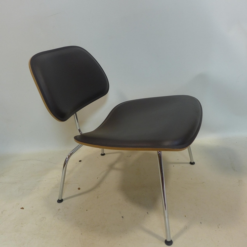 16 - An Eames LCM padded chair, Vitra serial no. to underside, raised on splayed legs, H.65cm...