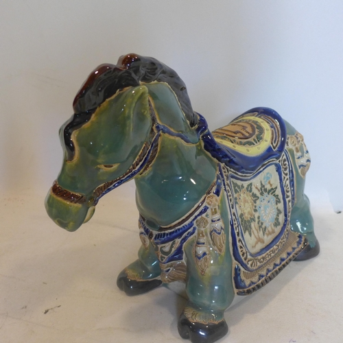 26 - A Chinese ceramic horse, polychrome decorated with flowers, H.30 L.40cm...