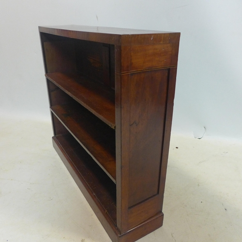 28 - An early 20th century inlaid mahogany open bookcase, raised on plinth base, H.73 W.86 D.21cm...