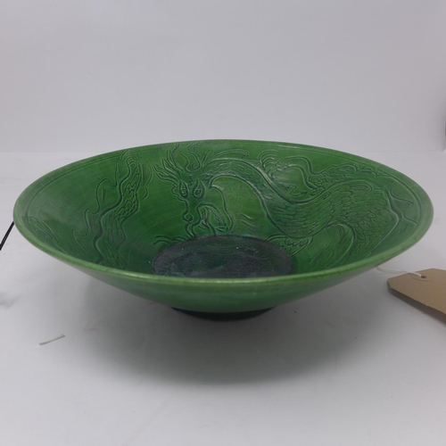 35 - A Chinese green glazed bowl with dragon design, H.7 D.22cm...