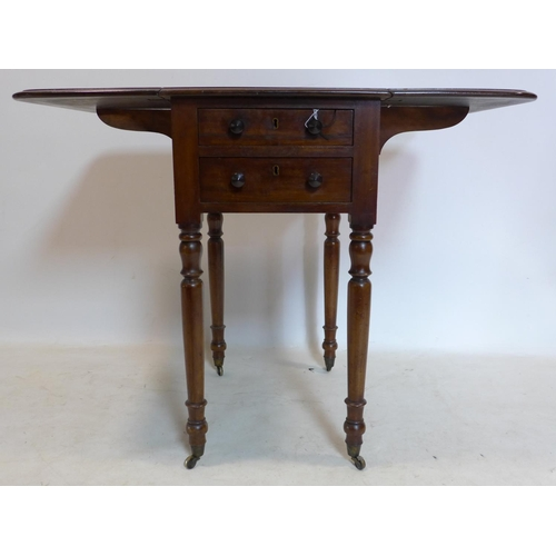 38 - A 19th century mahogany drop leaf side table, with 2 drawers, raised on turned legs and castors...