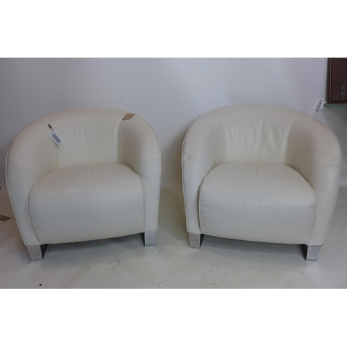 42 - A pair of Natuzzi white leather armchairs on chrome bases...