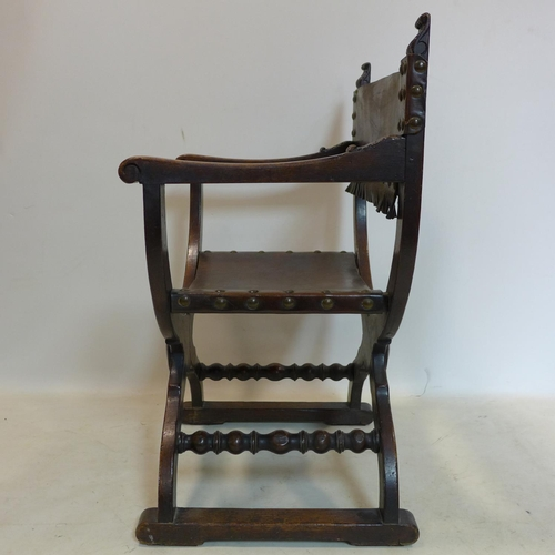 46 - A pair of early 19th century oak Savonarola chairs, with original studded leather...