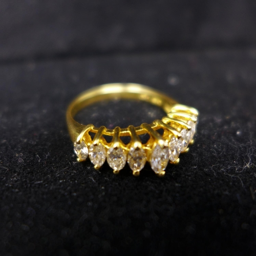 48 - A boxed 18ct yellow gold ring set to the centre with a row of 9 graduated, marquise-cut diamonds, si...