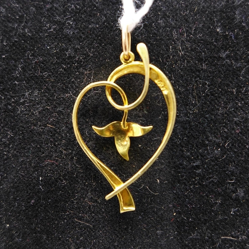 50 - A 15ct yellow gold, Art Nouveau seed pearl pendant set to a yellow gold pendant loop, 3.5 x 2cm appr...