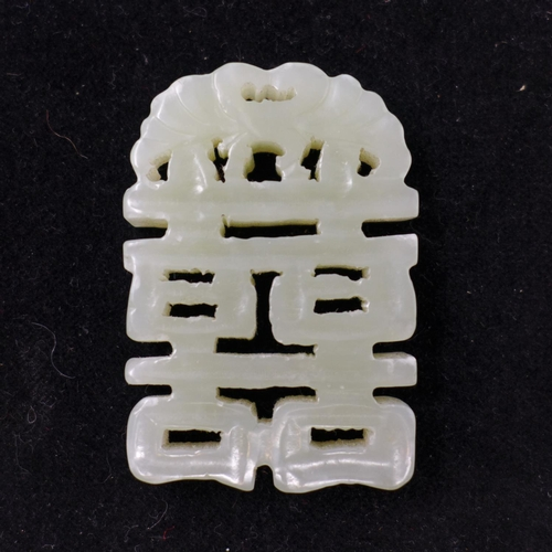53 - A Chinese, pale green or mutton-coloured carved jade of pierced form, 5 x 3.2cm, 29.4g pendant...