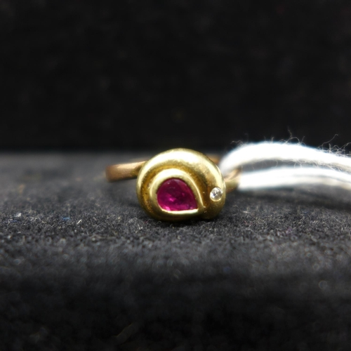 58 - An 18ct yellow gold ruby and diamond stylised snake ring on a rose gold shank, size: N, 2.4g...