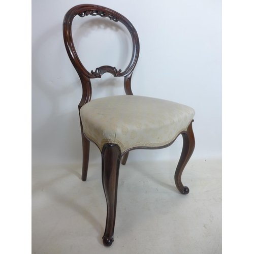 61 - A set of four Victorian rosewood balloon back dining chairs...