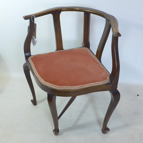 62 - An Edwardian mahogany corner chair...