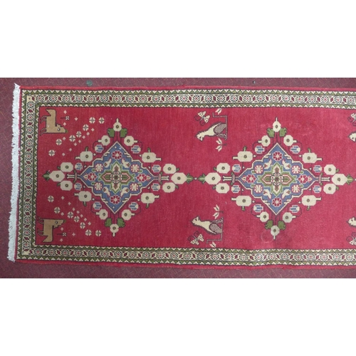 82 - A South West Persian Abedeh runner, bearing a repeating stylised pole medallion with animal motifs o...