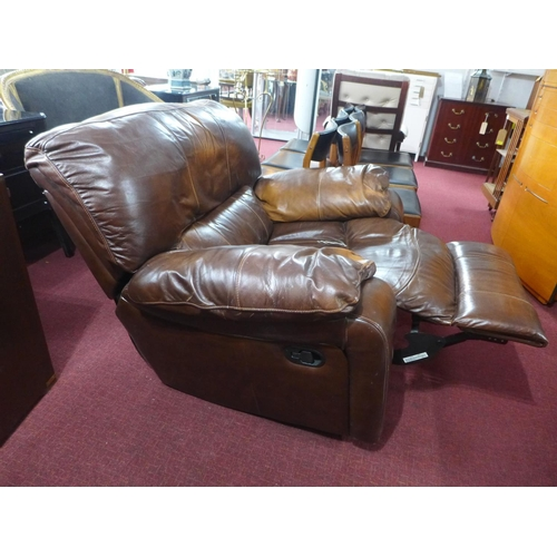 87 - A brown leather reclining armchair...
