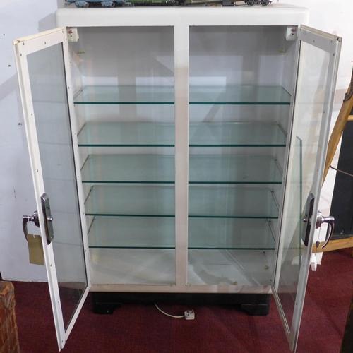 88 - A vintage medicine/dentists metal cabinet, with internal lights and glass shelves, H.147 W.95 D.40cm...