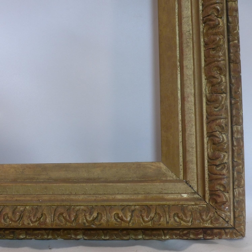 99 - A late 19th/early 20th century gilt wood picture frame, outer - 85 x 130cm inner - 62 x 108cm...