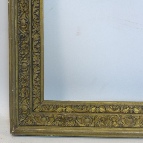 100 - A late 19th/early 20th century gilt wood picture frame, outer - 88 x 77cm inner - 76 x 65cm...