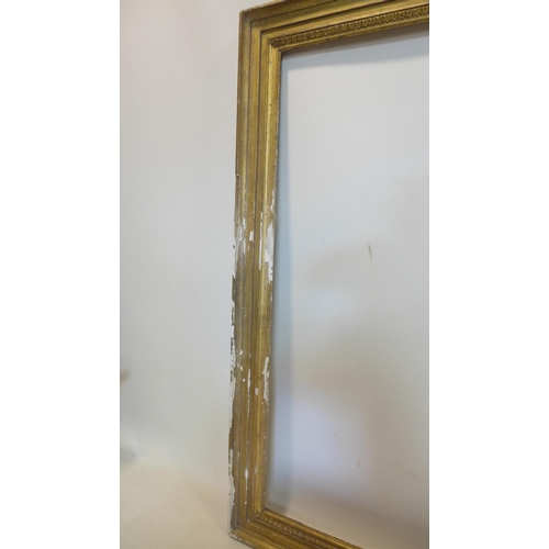 101 - A large 19th century gilt wood picture frame, outer -103 x 129cm inner - 87 x 113cm...