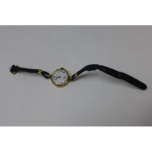 115 - a 1940'S 9ct yellow gold cased Omega ladies wristwatch on black leather strap with white enamel dial...
