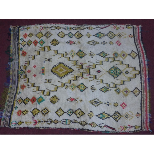 133 - An antique Moroccan Azilal rug, with Berber geometric and diamond motifs on a cream ground, 180 x 14...