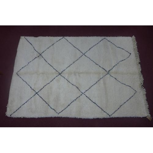 137 - A Moroccan Berber Beni Ourain carpet, with diamond design, 263 x 166cm...