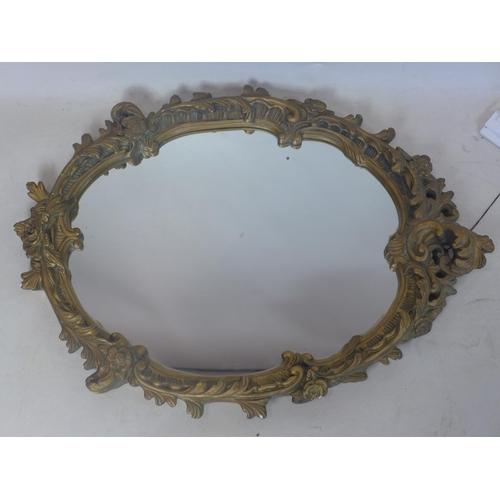 143 - A gilt plaster mirror, 65 x 48cm...
