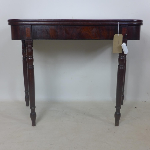 155 - A 19th century mahogany fold over tea table...