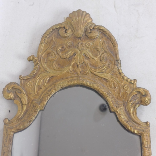 182 - A 19th century giltwood pier mirror, with scrolling floral decoration, 89 x 36cm...