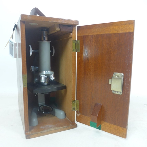 199 - A 20th century, wooden-cased microscope by 'Beck', Model 47 (1 DIV = .005 mm). case: 36 x 26 x 18cm....