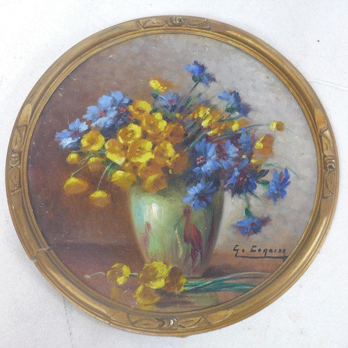 200 - G. Corbier, French, A gilt framed, circular oil on board depicting a floral still life, signed lower...