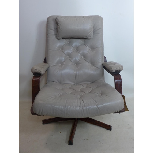 203 - A 20th century swivel chair, with button back leather upholstery on exotic hardwood base, H.101cm...