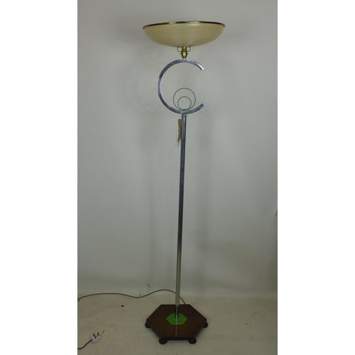205 - An Art Deco chrome standard lamp, with C design to support, plastic shade, raised on hexagonal oak b...